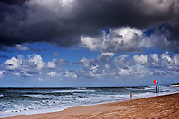 Beautiful seascape with dangerous surf under cloudy skies on North Shore of Oahu.
