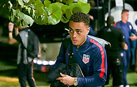 GEORGETOWN, GRAND CAYMAN, CAYMAN ISLANDS - NOVEMBER 19: Sergino Dest #18 of the United States walks to the USMNT locker room during a game between Cuba and USMNT at Truman Bodden Sports Complex on November 19, 2019 in Georgetown, Grand Cayman.