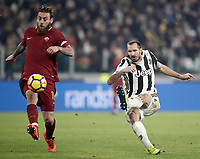 Calcio, Serie A: Juventus - AS Roma, Torino, Allianz Stadium, 23 dicembre, 2017. <br /> Juventus' captain Giorgio Chiellini (r) in action with Roma's captain Daniele D Rossi (l) during the Italian Serie A football match between Juventus and Roma at Torino's Allianz stadium, December 23, 2017.<br /> UPDATE IMAGES PRESS/Isabella Bonotto
