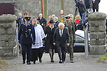 President Micheal D Higgins being treated by SUPT Andy Waters at The Funeral of Garda Anthony Golden RIP in St Oliver's church Blackrock Co Louth.<br /> <br /> Garda Golden was guned down in Omeath last Sunday.<br /> Picture Newsfile | Fran Caffrey