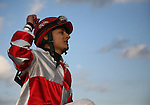 7 February 2009:  Jockey Gabriel Saez celebrates winning the Risen Star Stakes aboard Friesan Fire at the Fair Grounds Race Course in New Orleans, Louisiana.