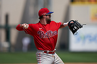 Philadelphia Phillies third baseman Luke Miller (30) throws to first base during a Minor League Spring Training game against the Detroit Tigers on April 17, 2021 at Joker Marchant Stadium in Lakeland, Florida.  (Mike Janes/Four Seam Images)