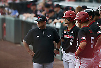 Nebraska head coach Will Bolt looks on, Monday, June 7, 2021 in the third inning of the NCAA Fayetteville Regional at Baum-Walker Stadium in Fayetteville. Check out nwaonline.com/210608Daily/ for today's photo gallery. <br /> (NWA Democrat-Gazette/Charlie Kaijo)