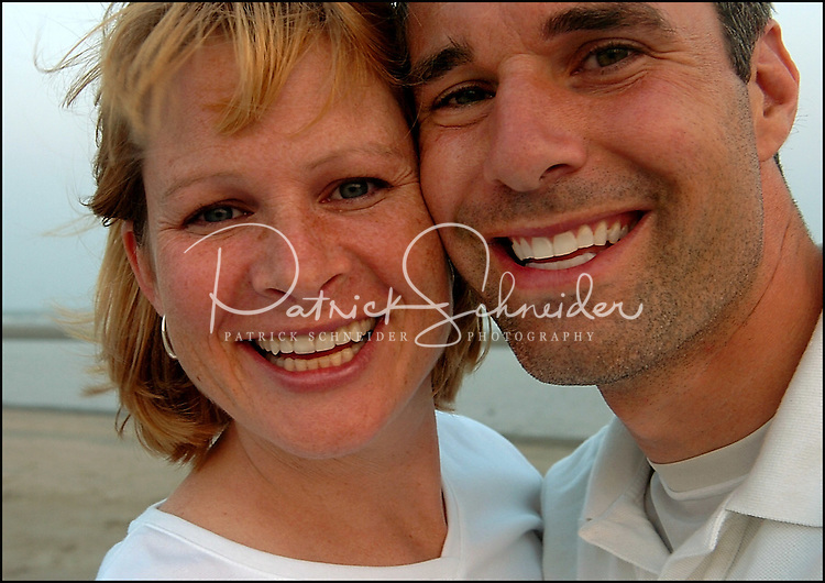 Close up photo of a man and woman with nice light on their faces. Taken while on vacation at the beach. Generic photo indicating love, relationship, friendship, etc.  Model released.