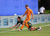 LAKE BUENA VISTA, FL - JULY 18: Pablo Bonilla #28 of the Portland Timbers is pushed by Adam Lundkvist #3 of the Houston Dynamo during a game between Houston Dynamo and Portland Timbers at ESPN Wide World of Sports on July 18, 2020 in Lake Buena Vista, Florida.