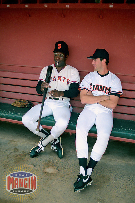 SAN FRANCISCO, CA - Bobby Bonds of the San Francisco Giants (left) smokes a cigarette and talks with Will Clark in the dugout before an old timers game at Candlestick Park in San Francisco, California in 1988. Photo by Brad Mangin