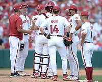Arkansas coach Dave Van Horn (left) speaks Friday, June 4, 2021, with reliever Kevin Kopps as he enters the game with two outs in the fourrh inning of the Razorbacks' 13-8 win over New Jersey Institute of Technology in the first game of the NCAA Fayetteville Regional at Baum-Walker Stadium in Fayetteville. Visit nwaonline.com/210605Daily/ for today's photo gallery.<br /> (NWA Democrat-Gazette/Andy Shupe)