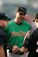 Down East Wood Ducks manager Corey Ragsdale (24) during the lineup exchange before a Carolina League game against the Fayetteville Woodpeckers on August 13, 2019 at SEGRA Stadium in Fayetteville, North Carolina.  Fayetteville defeated Down East 5-3.  (Mike Janes/Four Seam Images)