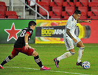 WASHINGTON, DC - SEPTEMBER 27: Gustavo Bou #7 of New England Revolution battles for the ball with Joseph Mora #28 of D.C. United during a game between New England Revolution and D.C. United at Audi Field on September 27, 2020 in Washington, DC.