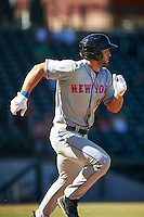 Scottsdale Scorpions designated hitter Tim Tebow (15), of the New York Mets organization, runs to first in the fourth inning after hitting a single to left field for his first hit of the Arizona Fall League season during a game against the Mesa Solar Sox on October 18, 2016 at Sloan Park in Mesa, Arizona.  Mesa defeated Scottsdale 6-3.  (Mike Janes/Four Seam Images)