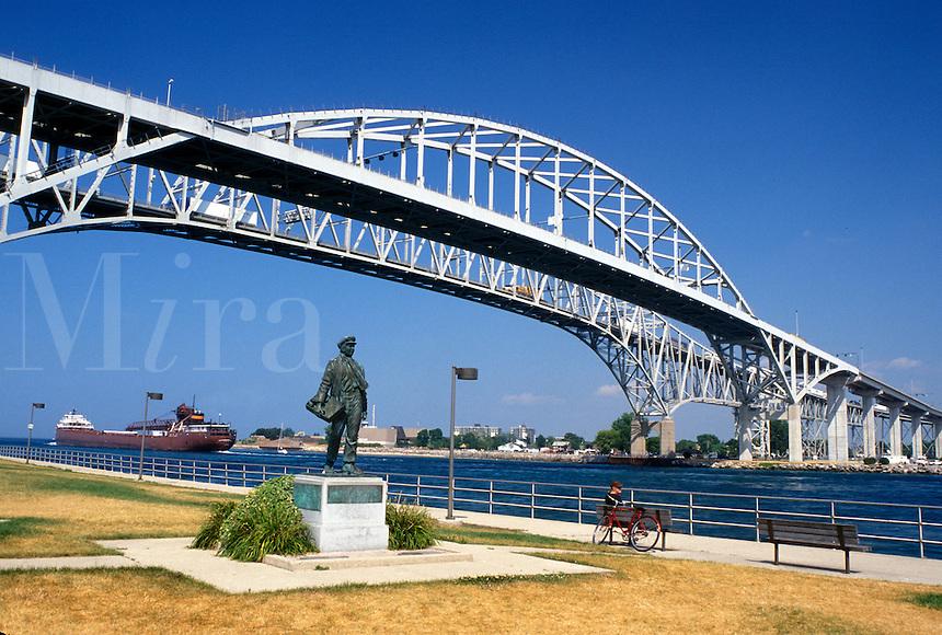 Port Huron, MI, Lake Huron, Michigan, Thomas Edison Statue below the Blue Water International Bridge which spans the St. Clair River at Port Huron.