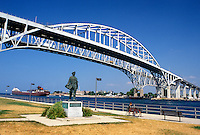 Port Huron, MI, Lake Huron, Michigan, Thomas Edison Statue below the Blue Water International Bridge which spans the St. Clair River at Port Huron.