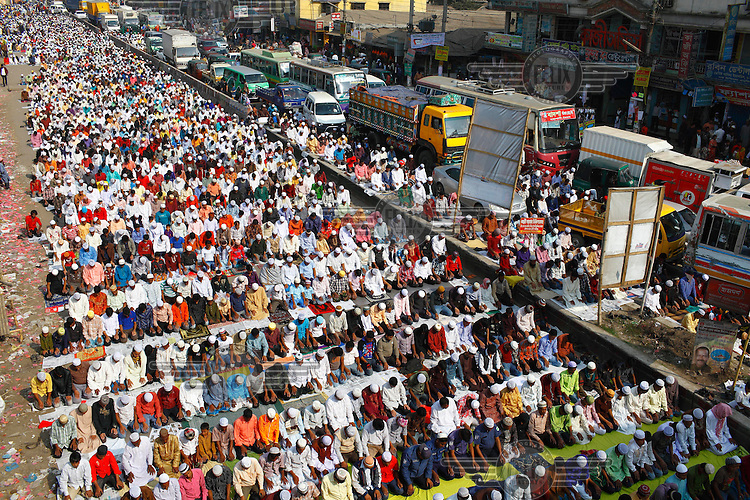 Devotees attend the Akhare Munajat (final prayer) of the Biswa Ijtema - one of the largest congregations of muslims in the world. Around two million Muslims attended the Friday noon prayers at Tongi, on the outskirts of Dhaka. ..