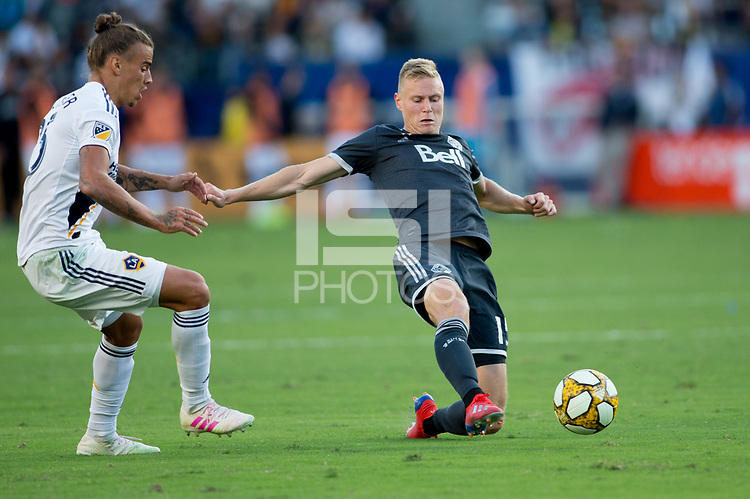 CARSON, CA - SEPTEMBER 29: Andy Rose #15 of the Vancouver Whitecaps reaches for a ball during a game between Vancouver Whitecaps and Los Angeles Galaxy at Dignity Health Sports Park on September 29, 2019 in Carson, California.
