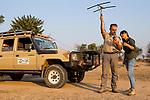 African Lion (Panthera leo) biologists, Luke Hunter and Kim Young-Overton, tracking female lion using telemetry, Kafue National Park, Zambia