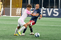 FOXBOROUGH, MA - SEPTEMBER 04: Michael Vang #8 Forward Madison FC fends off Tiago Mendonca #33 of New England Revolution II as he passes the ball during a game between Forward Madison FC and New England Revolution II at Gillette Stadium on September 04, 2020 in Foxborough, Massachusetts.
