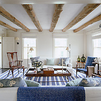A blue and white palette and simple furniture bring a freshness to this country living room