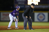 Third base umpire Kevin Morgan works the NCAA baseball game between the St. John's Red Storm and the Western Carolina Catamounts at Childress Field on March 12, 2021 in Cullowhee, North Carolina. (Brian Westerholt/Four Seam Images)
