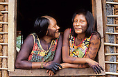 A-Ukre village, Brazil. Paiponu and Paingroti, two Kayapo women share a joke; Xingu Indigenous Area, Para State.