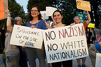 People gather in support of Charlottesville and against white nationalist neo Nazi anti semitic fascist violence in Waltham MA 8.14.17