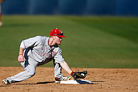 Jake Placzek #23 of the Nebraska Cornhuskers waits to apply the tag during a game against the Cal State Fullerton Titans at Goodwin Field on February 16, 2013 in Fullerton, California. Cal State Fullerton defeated Nebraska 10-5. (Larry Goren/Four Seam Images)