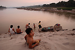 Villagers bathe in the Mekong River at Ban Khe, a small village north of Pak Lai, Laos on Friday, March 7, 2008.  (photo by Khampha Bouaphanh).
