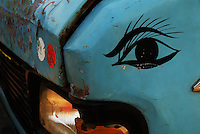 A blue truck sports a painted eye beside the headlight, New Delhi, India