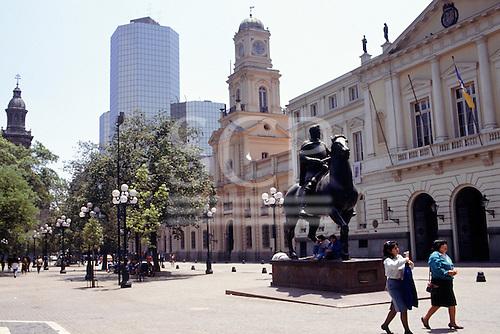 Santiago, Chile. Statue of Pedro de Valdivia in the Plaze de Armas with colonial and modern buildings.