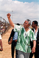 Nelson Mandela greets supporters at an African National Congress (ANC) rally.