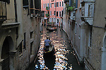 Gondolier on a small canal, Venice, Italy, Europe. .  John offers private photo tours in Denver, Boulder and throughout Colorado, USA.  Year-round. .  John offers private photo tours in Denver, Boulder and throughout Colorado. Year-round.