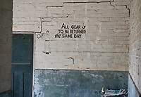 ©Si Barber 07739 472 922. <br /> A sign in the quartermaster's stores now derelict buildings at former US Air Force base RAF Flixton, Suffolk.<br /> <br /> USAGE TERMS: ONE USE IN PRINT AND ONLINE. NO SYNDICATION, RETENTION, OR THIRD PARTY SALES. MINIMUM FEES APPLY