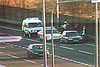 Image from a police motorway traffic cctv camera. The police officers are attending an incident on the hardshoulder. This image may only be used to portray the subject in a positive manner..©shoutpictures.com..john@shoutpictures.com