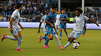 KANSAS CITY, KS - MAY 29: Memo Rodriguez #8 of Houston Dynamo FC dribbles upfield as Luis Martins #36, Gadi Kinda #17 and Gianluca Busio #10 of Sporting KC try to track him during a game between Houston Dynamo and Sporting Kansas City at Children's Mercy Park on May 29, 2021 in Kansas City, Kansas.