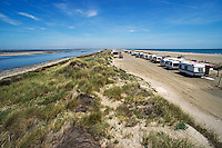 Caravans aligned on beach as a wild campsite, Piemanson beach,Camargue, France