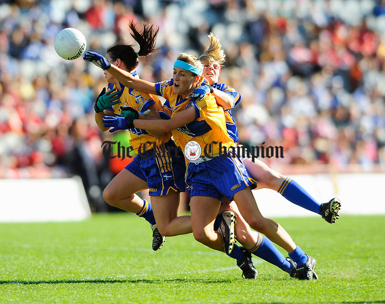 Clare's Grace Lynch and Michelle Delaney contest a ball with Tipperary's Aoife O Dwyer during the Intermediate Ladies Football final at Croke Park. Photograph by John Kelly.