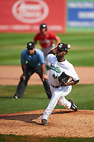 Clinton LumberKings pitcher Ronald Dominguez (41) delivers a pitch as umpire Zach Tieche looks on with a baserunner leading off second during a game against the Great Lakes Loons on August 16, 2015 at Ashford University Field in Clinton, Iowa.  Great Lakes defeated Clinton 3-2.  (Mike Janes/Four Seam Images)