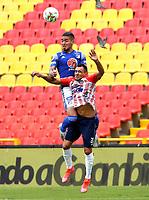 BOGOTA - COLOMBIA, 13-06-2021: Cristian Arango de Millonarios F. C. y Marlon Piedrahita de Atletico Junior disputan el balon durante partido entre Millonarios F. C. y Atletico Junior de vuelta de las Semifinales por la Liga BetPlay DIMAYOR I 2021 jugado en el estadio Nemesio Camacho El Campin de la ciudad de Bogota. / Cristian Arango of Millonarios F. C. and Marlon Piedrahita of Atletico Junior figth for the ball during a match between Millonarios F. C. and Atletico Junior of the second leg of the Semifinals for the BetPlay DIMAYOR I 2021 League played at the Nemesio Camacho El Campin Stadium in Bogota city. / Photo: VizzorImage / Daniel Garzon / Cont.