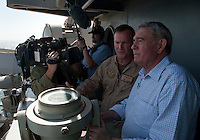 120310-N-DR144-030 ARABIAN GULF (March 10, 2012)  Emmy Award-winning Broadcast Journalist Dan Rather talks with Commander Carrier Strike Group 1 Rear Adm. Thomas K. Shannon while observing a transit of the Strait of Hormuz from the signal bridge aboard the Nimitz-class aircraft carrier USS Carl Vinson (CVN 70). Carl Vinson and Carrier Air Wing (CVW) 17 are deployed to the U.S. 5th Fleet area of responsibility.  (U.S. Navy photo by Mass Communication Specialist 2nd Class James R. Evans/Released)