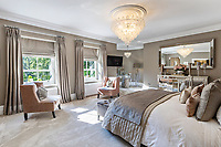 BNPS.co.uk (01202 558833)<br /> Pic: Savills/BNPS<br /> <br /> Pictured: A bedroom.<br /> <br /> A striking turreted French style chateau in one of the UK's most desirable streets is on the market for £9.25m.<br /> <br /> Deauville is an impressive mansion with a striking period exterior but a stylish contemporary look inside and all the mod cons a home owner would want, including an indoor pool complex and cinema room.<br /> <br /> The house is in the prestigious St George's Hill estate in Weybridge, Surrey, which is renowned all over the world.<br /> <br /> The five-bedroom house was built in 2000 but has undergone an extensive refurbishment in the last few years.