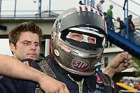 Sept. 30, 2012; Madison, IL, USA: NHRA crew member for funny car driver Tony Pedregon during the Midwest Nationals at Gateway Motorsports Park. Mandatory Credit: Mark J. Rebilas-