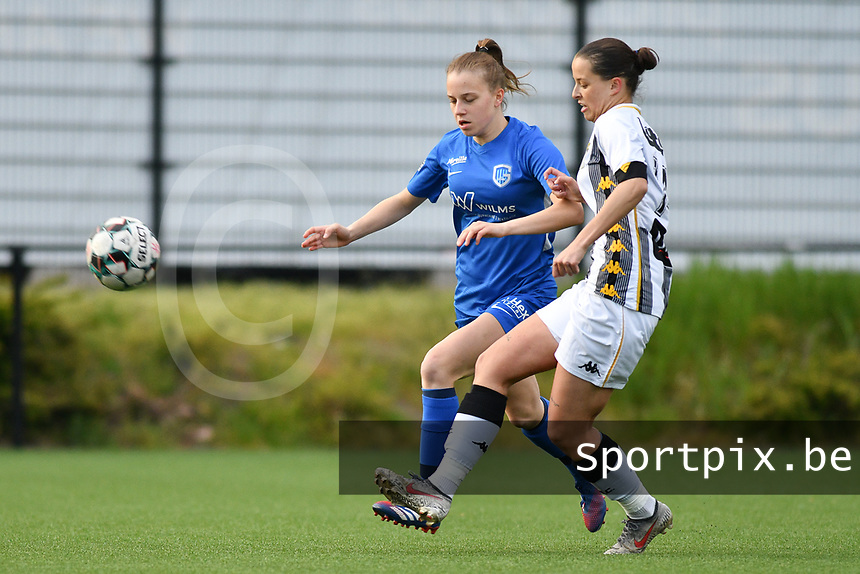 Luna Vanhoudt (43) of KRC Genk and Alysson Duterne (14) of Sporting Charleroi in action during a female soccer game between Sporting Charleroi and KRC Genk on the 4 th matchday in play off 2 of the 2020 - 2021 season of Belgian Scooore Womens Super League , friday 30 th of April 2021  in Marcinelle , Belgium . PHOTO SPORTPIX.BE | SPP | Jill Delsaux