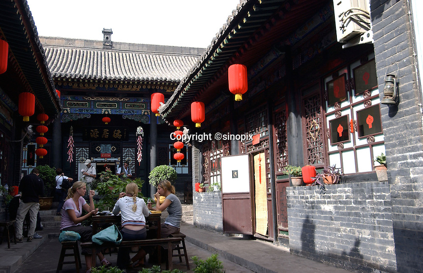 Western tourists enjoying meals in the local restaurant of Pingyao in Shannxi, which is one of the last cities in China that retains traditional Chinese architecture..19-SEP-04