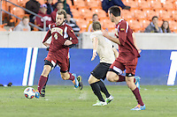 Houston, TX - Friday December 9, 2016: Reagan Dunk (4) of the Denver Pioneers races for the goal against the Wake Forest Demon Deacons at the NCAA Men's Soccer Semifinals at BBVA Compass Stadium in Houston Texas.