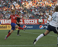 Korea Republic midfielder Park Heeyoung (17) clears the ball. In an international friendly, the U.S. Women's National Team (USWNT) (white/blue) defeated Korea Republic (South Korea) (red/blue), 4-1, at Gillette Stadium on June 15, 2013.