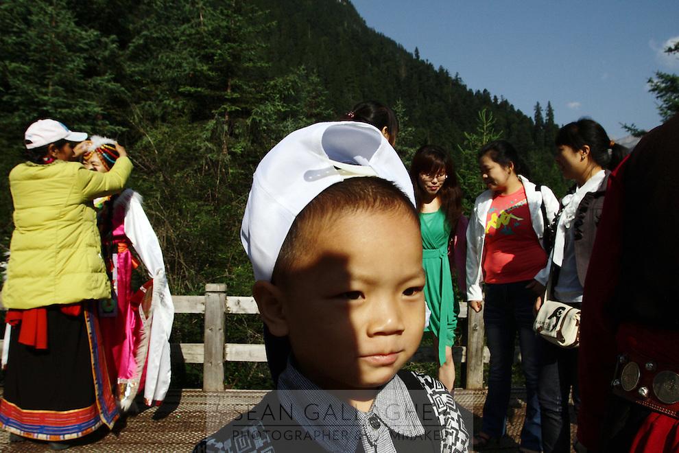 Tourists dressing up in Tibetan dress in the Jiuzhaigou National Park. Sichuan Province. China.