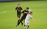 LOS ANGELES, CA - SEPTEMBER 13: Latif Blessing #7 of LAFC goes head to head with Marvin Loría #44 of the Portland Timbers during a game between Portland Timbers and Los Angeles FC at Banc of California stadium on September 13, 2020 in Los Angeles, California.