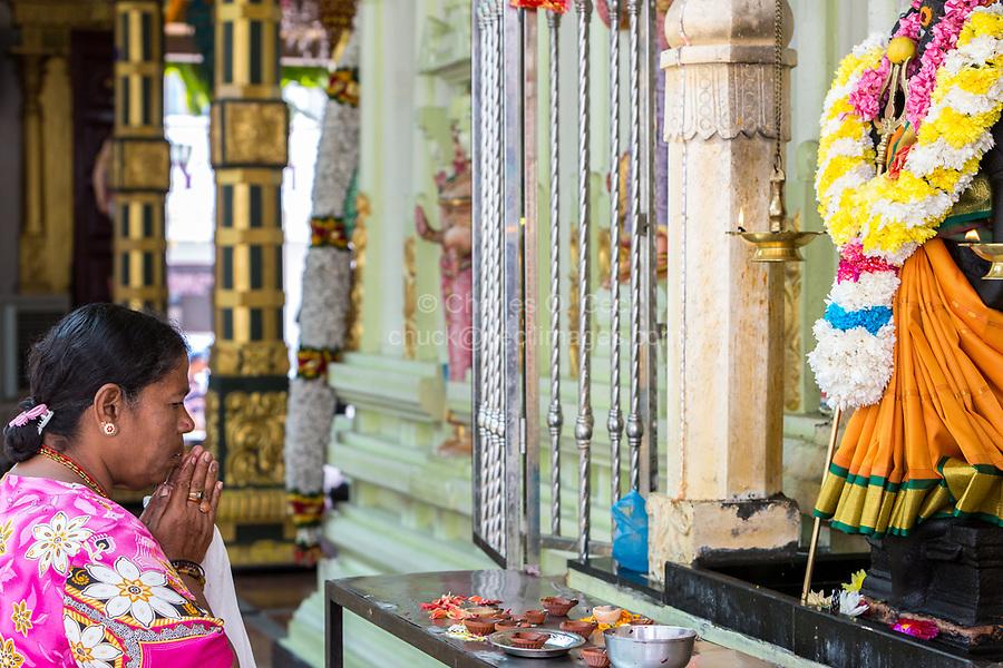 Woman Praying at Shrine to Hindu Goddess Durga, Sri Maha Mariamman Temple, George Town, Penang, Malaysia.