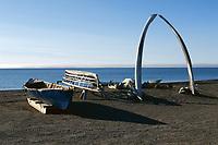 Jawbones of a Bowhead Whale, Balaena mysticetus, form the Archway. Umiaks beside it. Barrow. N.Alaska., Arctic