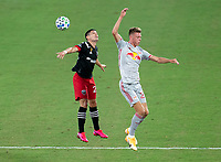 WASHINGTON, DC - SEPTEMBER 12: Mathias Jørgensen #25 of the New York Red Bulls goes up for a header with Joseph Mora #28 of D.C. United during a game between New York Red Bulls and D.C. United at Audi Field on September 12, 2020 in Washington, DC.