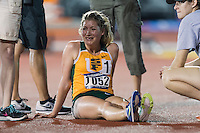 Jana Soethout of San Francisco is attended by track officials after retiring out of the 10000 meter semifinal during West Preliminary Track and Field Championships, Friday, May 29, 2015 in Austin, Tex. (Mo Khursheed/TFV Media via AP Images)